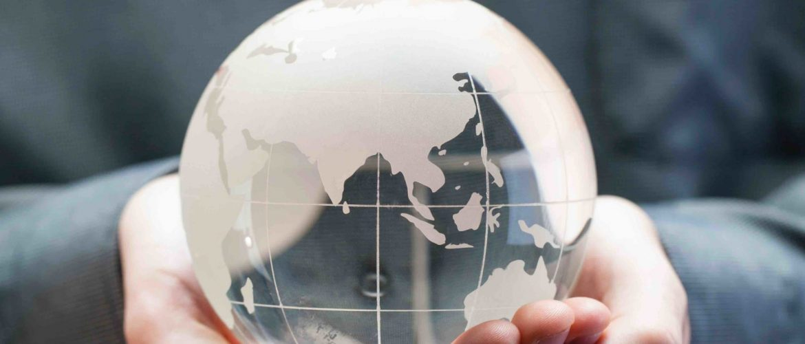 Hands holding model glass globe